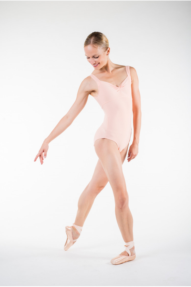 Wear Moi Galate peach leotard.